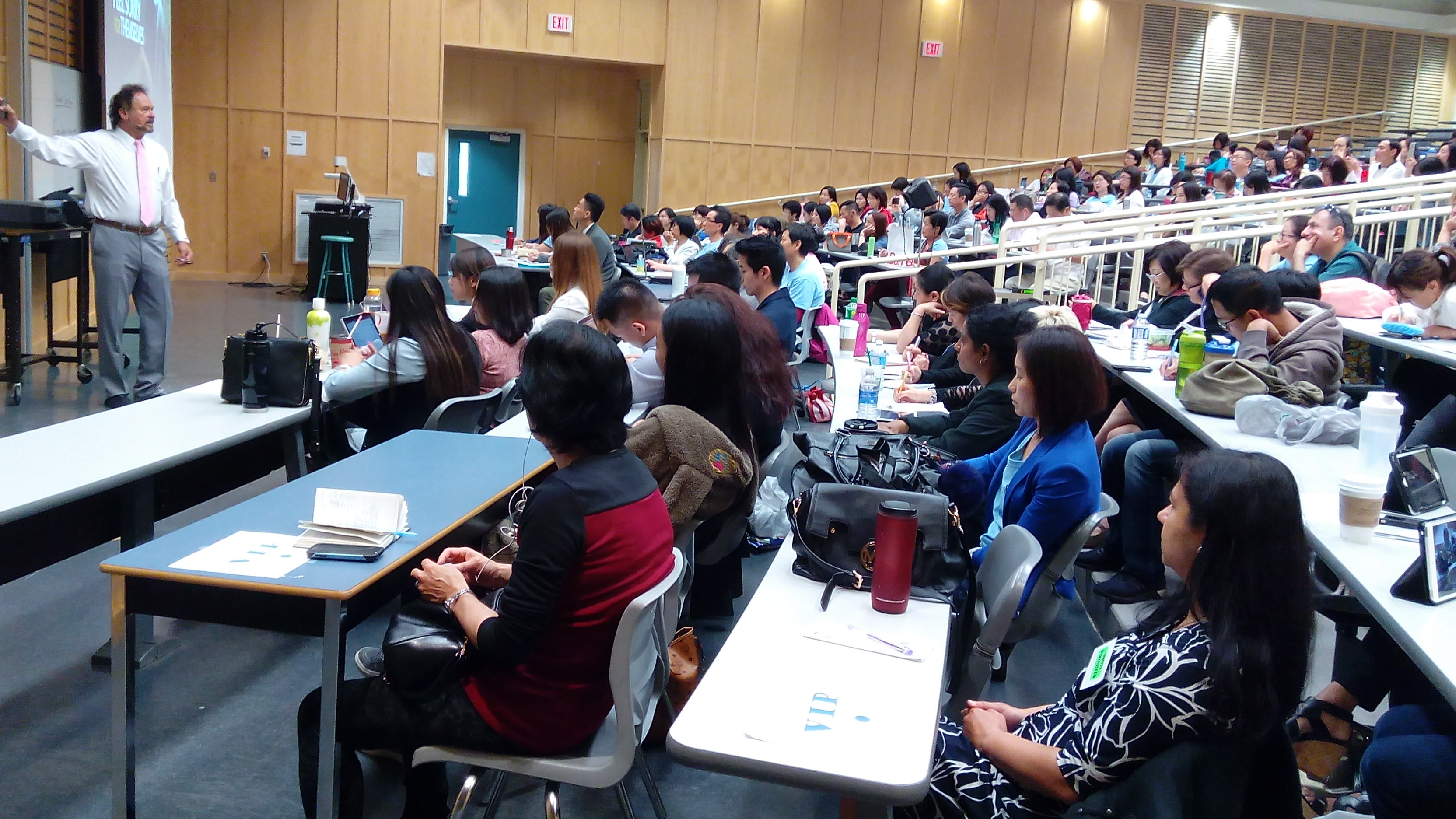 Both lecture rooms are packed for Dennis Frank's training
